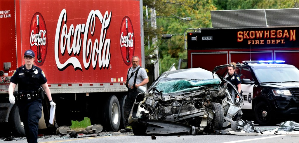 Police and Skowhegan firefighters investigate a serious accident involving a passenger car and a Coca-Cola truck on Route 2 in Skowhegan on Tuesday.