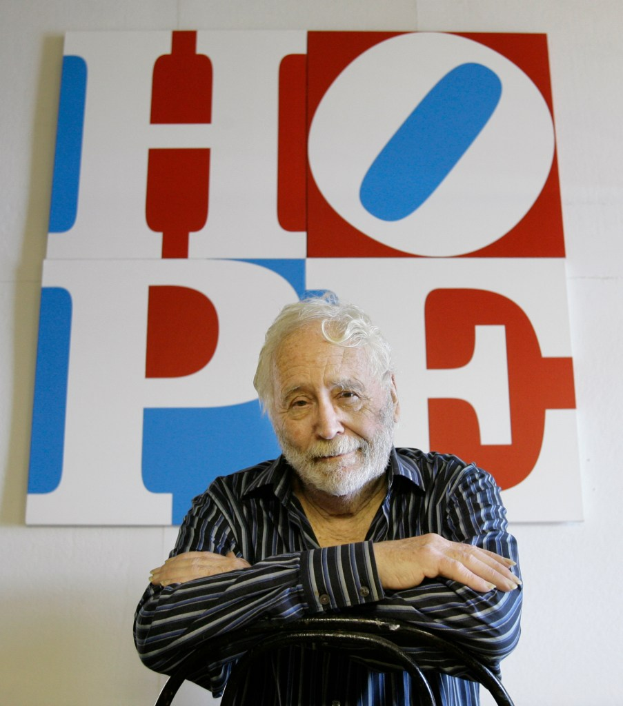 """Artist Robert Indiana poses at his Vinalhaven studio in 2008 with """"HOPE,"""" which he created for Barack Obama's presidential campaign."""