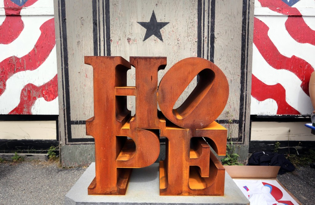 """A steel version of Robert Indiana's HOPE sculpture is displayed outside his home on the first annual """"International HOPE Day on his 86th birthday, Sept. 13, 2014, on Vinalhaven Island."""