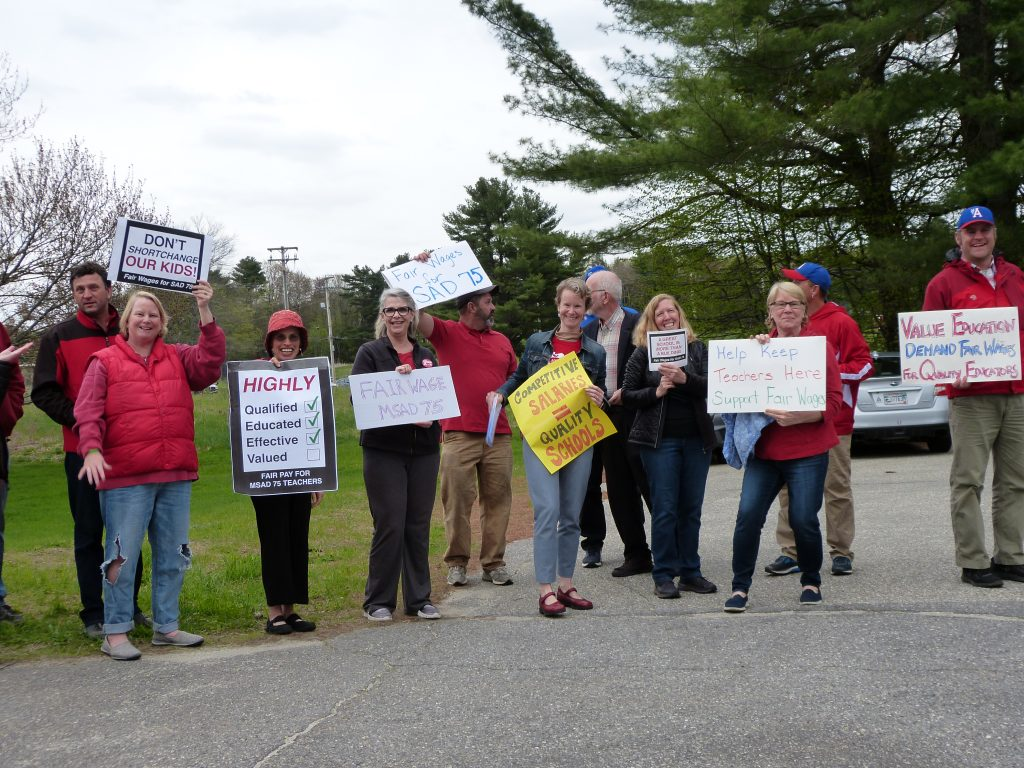 Merrymeeting Teacher Associations members and supporters stand near the entrance to Mt. Ararat Middle School on Thursday before the start of the School Administrative District 75 budget meeting.