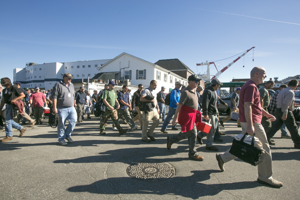 Workers leave the main gate at Bath Iron Works. Union officials are seeking clarification on new pension rules that have some workers worried about retirement ages and benefits.