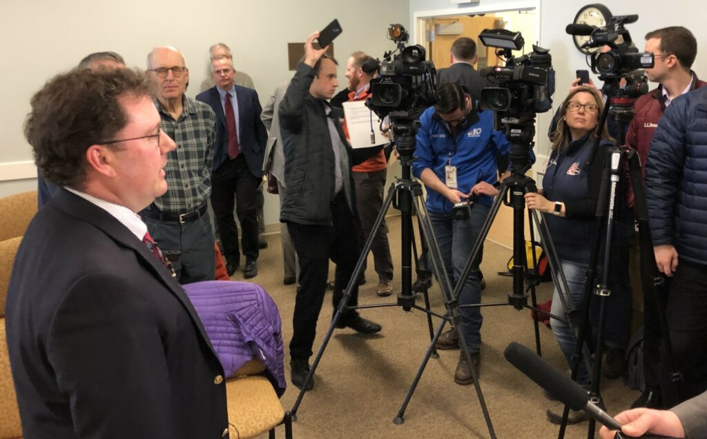 Mark Vannoy, former chairman of the Public Utilities Commission, speaks with reporters in April after the commission voted to grant a crucial certificate for Central Maine Power's proposed 145-mile transmission line from Quebec to Lewiston.