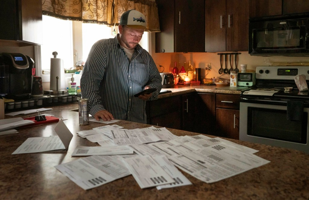 Michael Harvey of Winthrop researches upcoming Maine Public Utilities Commission hearings related to the bungled rollout of Central Maine Power's new billing system. The fiasco led to inaccurate or skyrocketing bills for more than 100,000 customers. Harvey, 39, has received monthly bills as high as $1,400 to power his 1,100-square-foot home.
