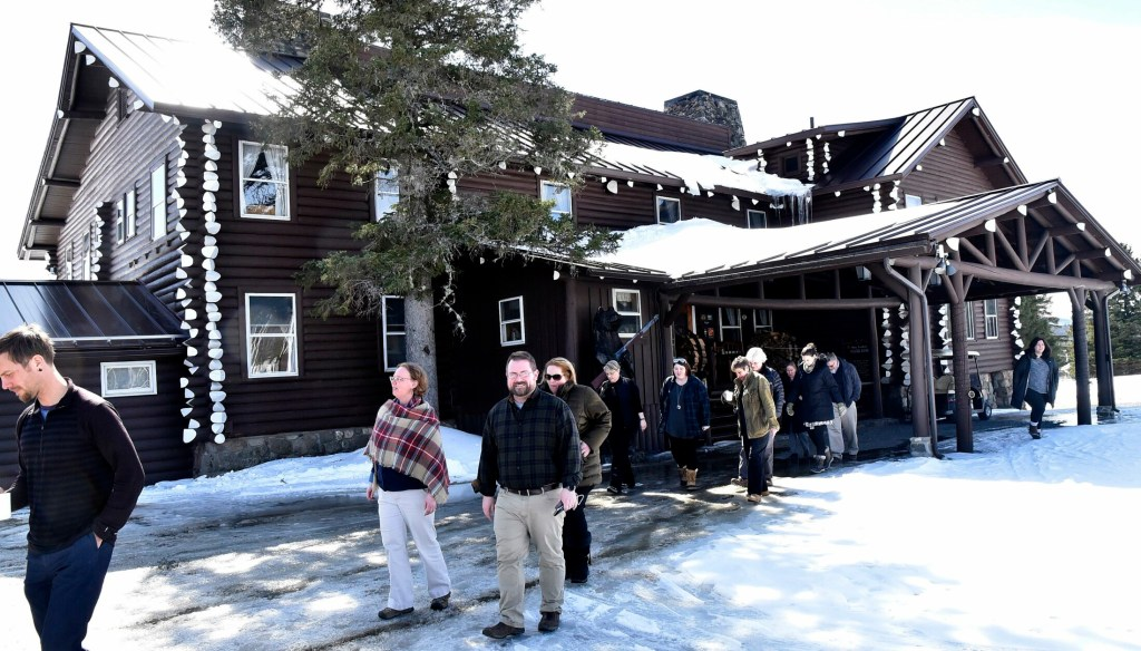 Unity College administrators and staff members exit Sky Lodge in Moose River to tour the property in March 2018. John and Elaine Couri, of the Couri Foundation, have added a welcoming center to their gift to the college.