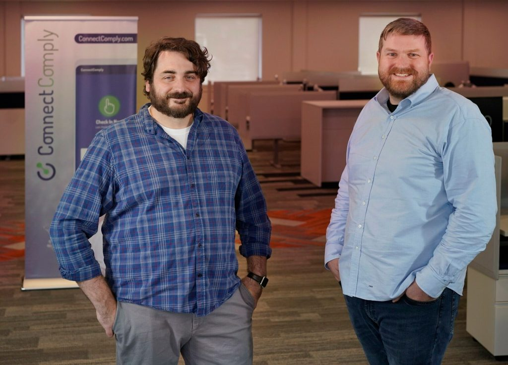 Stephen Quirk, left, and Sam Hotchkiss pose for a photo in the office of their startup company, Call2Test, in Cumberland. The company has developed an app to improve efficiency and accountability of people on probation or parole.