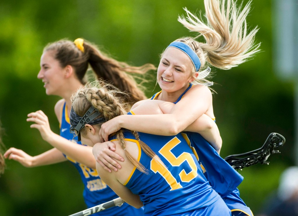 Lake Region teammates Shayla Dunn and Kendyl Ridlon after the Lakers beat Winslow 9-6 in the Class C quarterfinals on Saturday at Thomas College in Waterville.