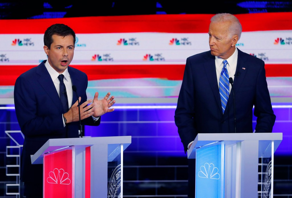 South Bend Mayor Pete Buttigieg speaks during the Democratic primary debate on June 27 as former Vice President Joe Biden listens.