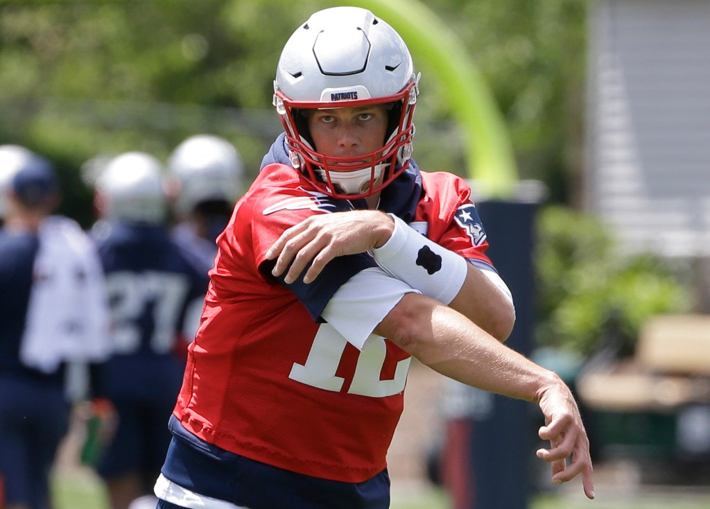 New England Patriots quarterback Tom Brady follows through after throwing the ball during a minicamp practice Tuesday in Foxborough, Mass.
