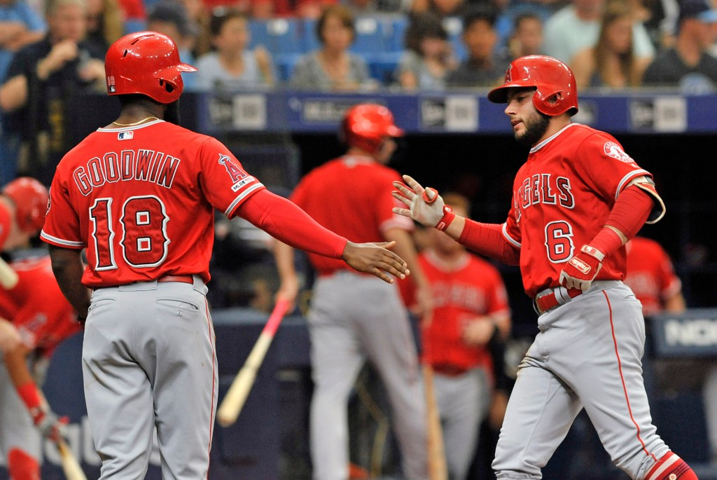 The Angels' Brian Goodwin, left, celebrates with David Fletcher after Fletcher's two-run home run off Tampa Bay Rays starter Charlie Morton in the second inning of the Angels' 5-3 win Saturday in St. Petersburg, Fla.