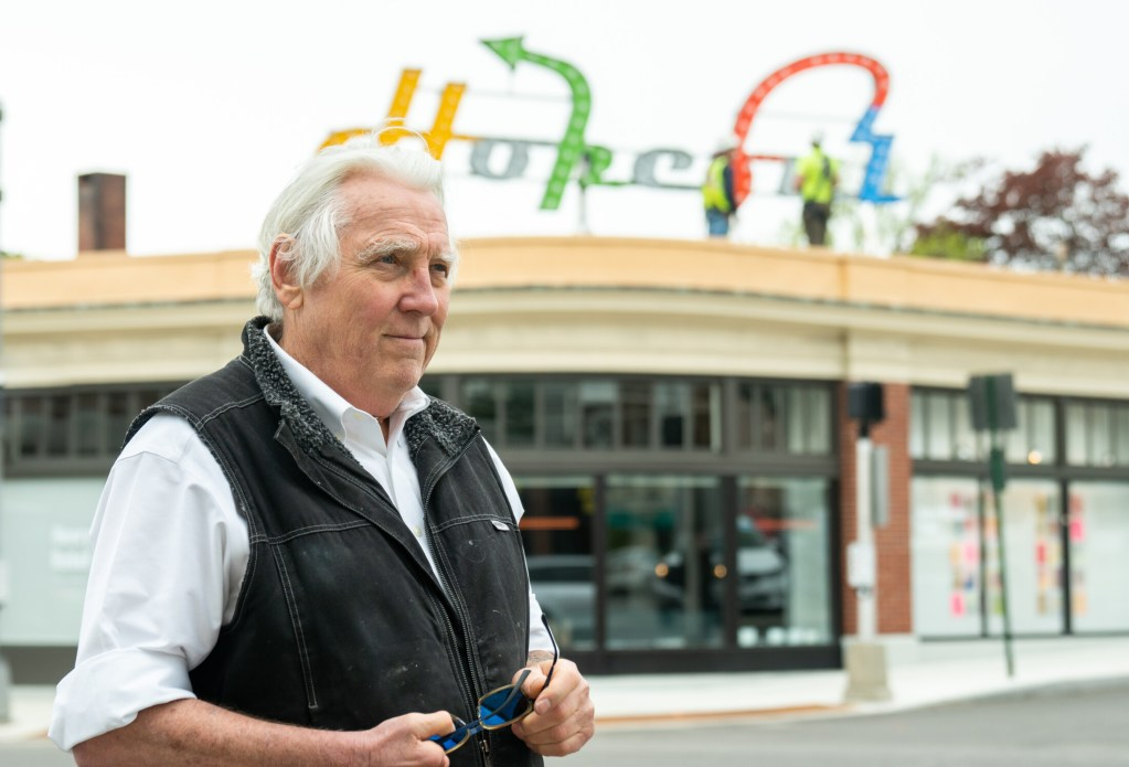 """Artist Charlie Hewitt at the installation of his """"A Hopeful Prayer for Portland"""" sculpture at Woodfords Corner."""