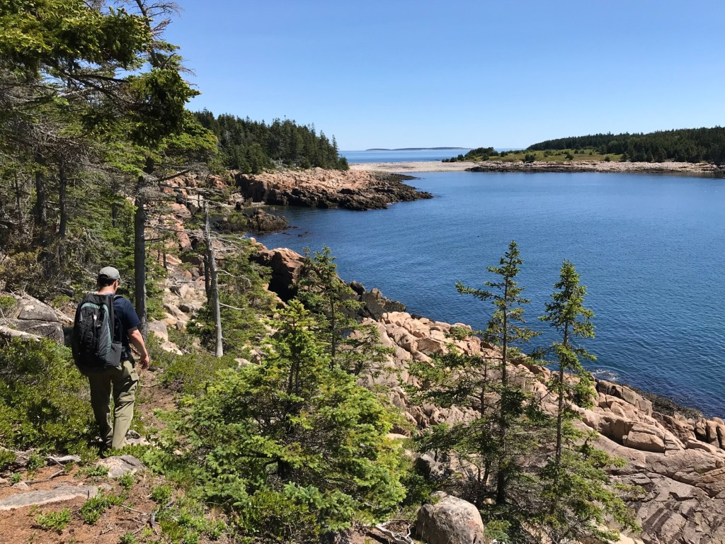 Jeff Romano hikes along Bluff Head headed to West Cove. Nearly 1,200 acres on the island of Frenchboro are preserved, one of the reasons the trails there are extraordinary.