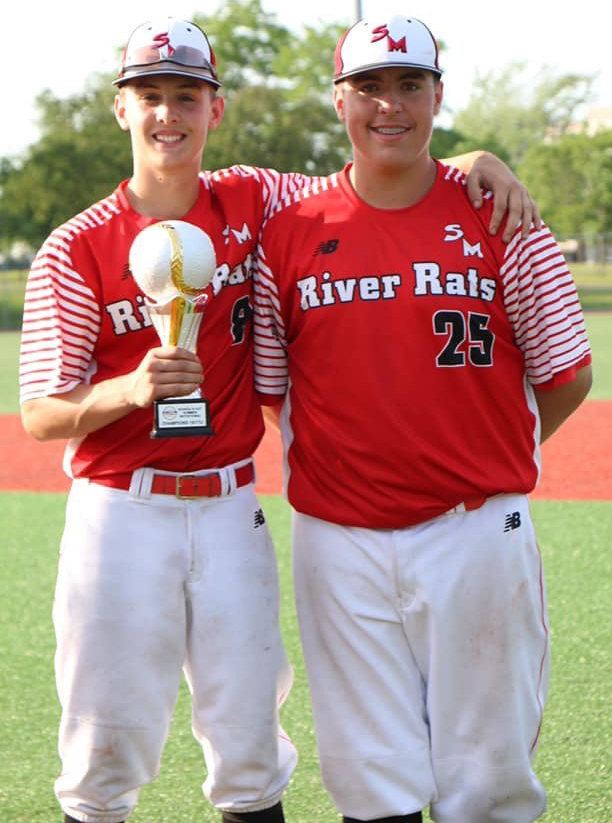 Damon (left) and Post pose with the new hardware the River Rats picked up in Quebec this past weekend.