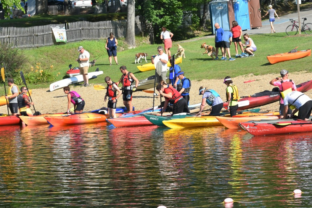 "Kayakers on Messalonskee Lake prepare for the first leg of the Paddle, Pedal and Pound Triathalon at last year's Oakfest. The event includes a 2.5 mile kayak/canoe, a 12-mile bike ride and a 3.1 mile run to the finish. To register, visit ""Events"" at oakfestmaine.com."