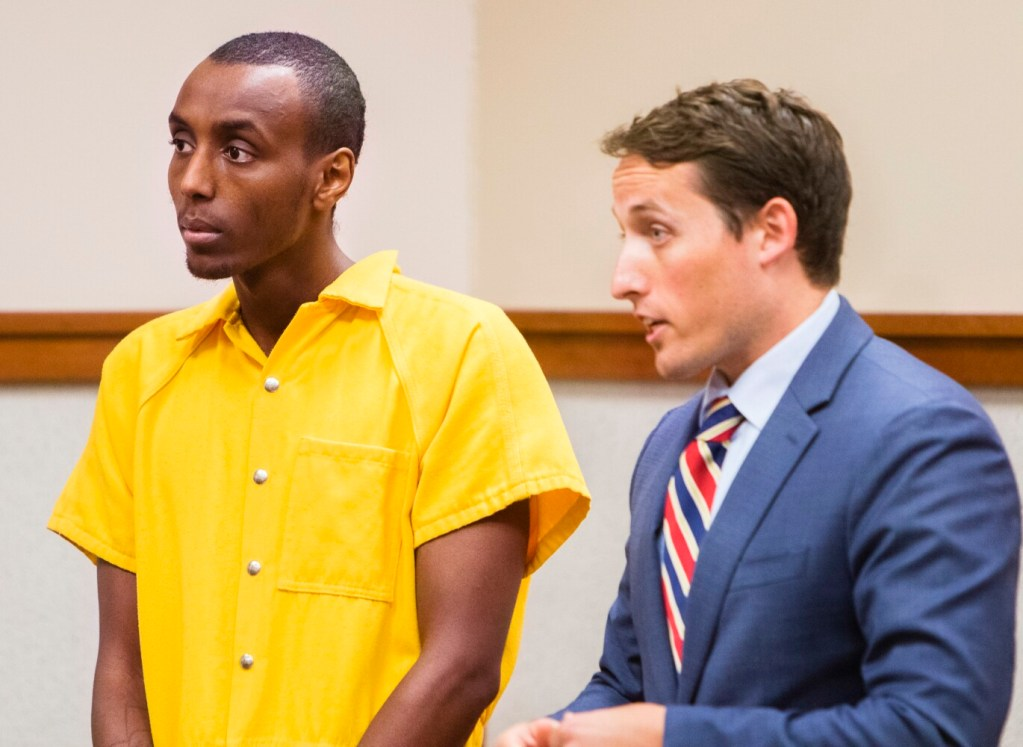 Mohamed Noh appears with his defense attorney  in Cumberland County Superior Court in Portland on Monday, on charges that he stabbed his mother in their Harrison home on Friday.