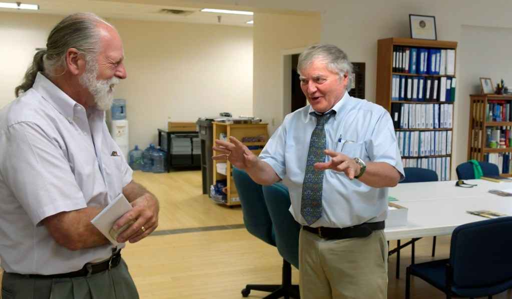 Rob Gordon, right, speaks with Richard Parkhurst on Wednesday at the United Way offices in Augusta. Gordon is retiring from the United Way, which the Parkhurst family has supported for several years.