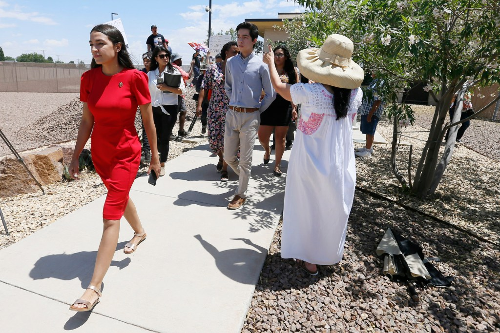 U.S. Rep. Alexandria Ocasio-Cortez, D-New York, walks to the front of the Clint Border Patrol station to talk about what she saw at border facilities Monday.