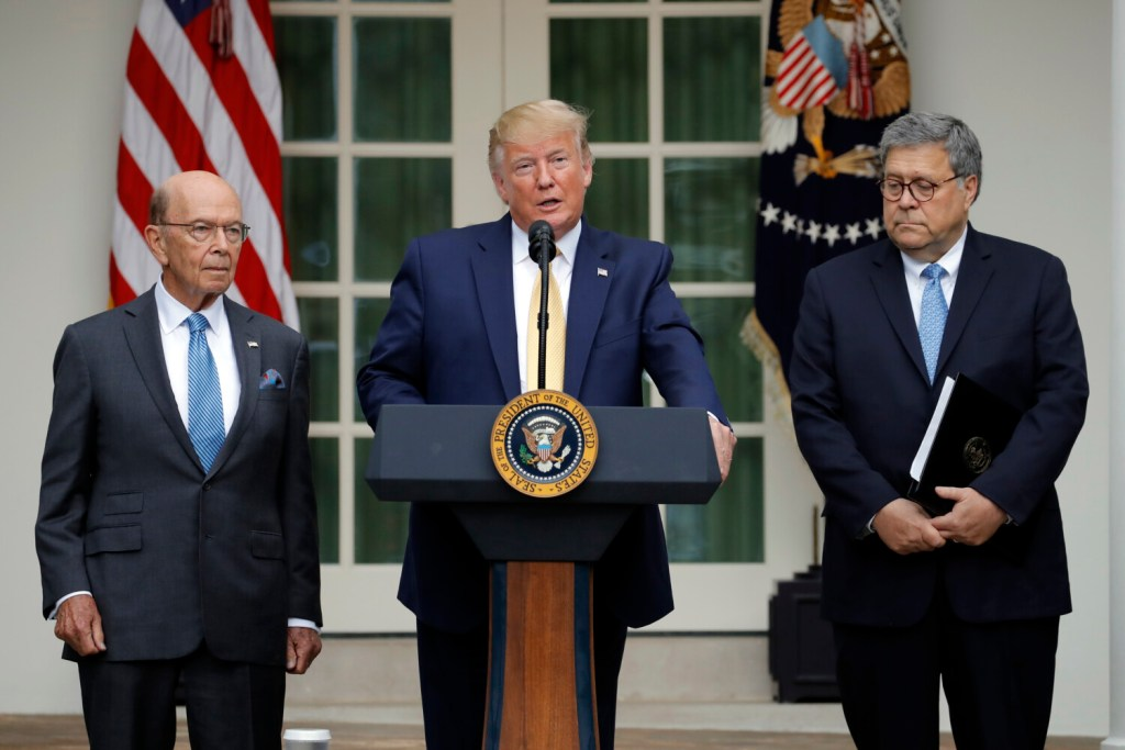 President Trump is joined by Commerce Secretary Wilbur Ross and Attorney General William Barr, right, as he speaks at the White House on Thursday.