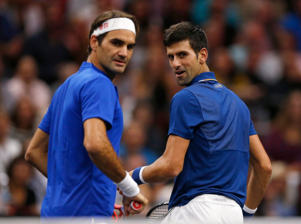 Roger Federer, left, and Novak Djokovic played for Team Europe in the Laver Cup in September, but face each other in the Wimbledon men's final on Sunday.