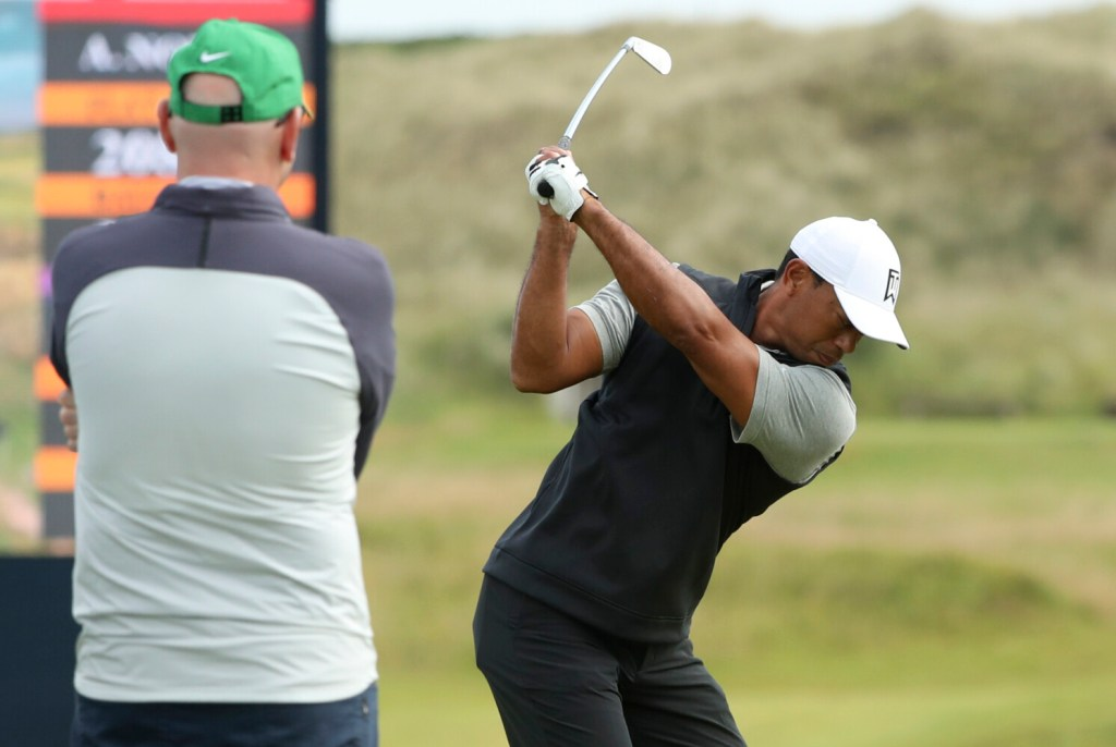 Tiger Woods of the United States hits a shot at the practice ground ahead of the start of the British Open golf championships at Royal Portrush golf course in Northern Ireland, Tuesday, July 16, 2019. The British Open starts Thursday. (AP Photo/Jon Super)
