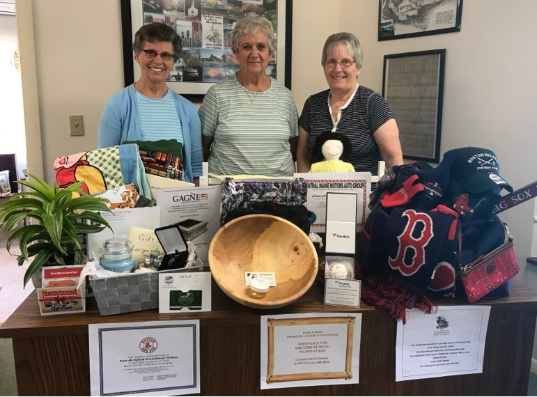 The Friends of the Belgrade Public Library will host its Live & Silent Auction Fundraiser starting at 7 p.m. Sunday, Aug. 18, at the Community Center for All Seasons. From left are Judy Johnson, Beverly Megill and Joan MacKenzie standing in front of some of the auction items.