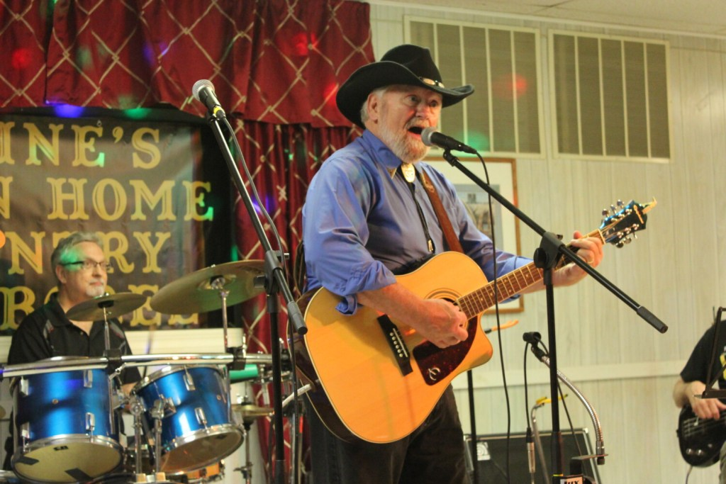 """Bob Heller, center, host of """"Maine's Down Home Country Jamboree,"""" performs a traditional country song during a taping of the new Fox 22 show Sunday night at 21 College Ave. in Waterville."""