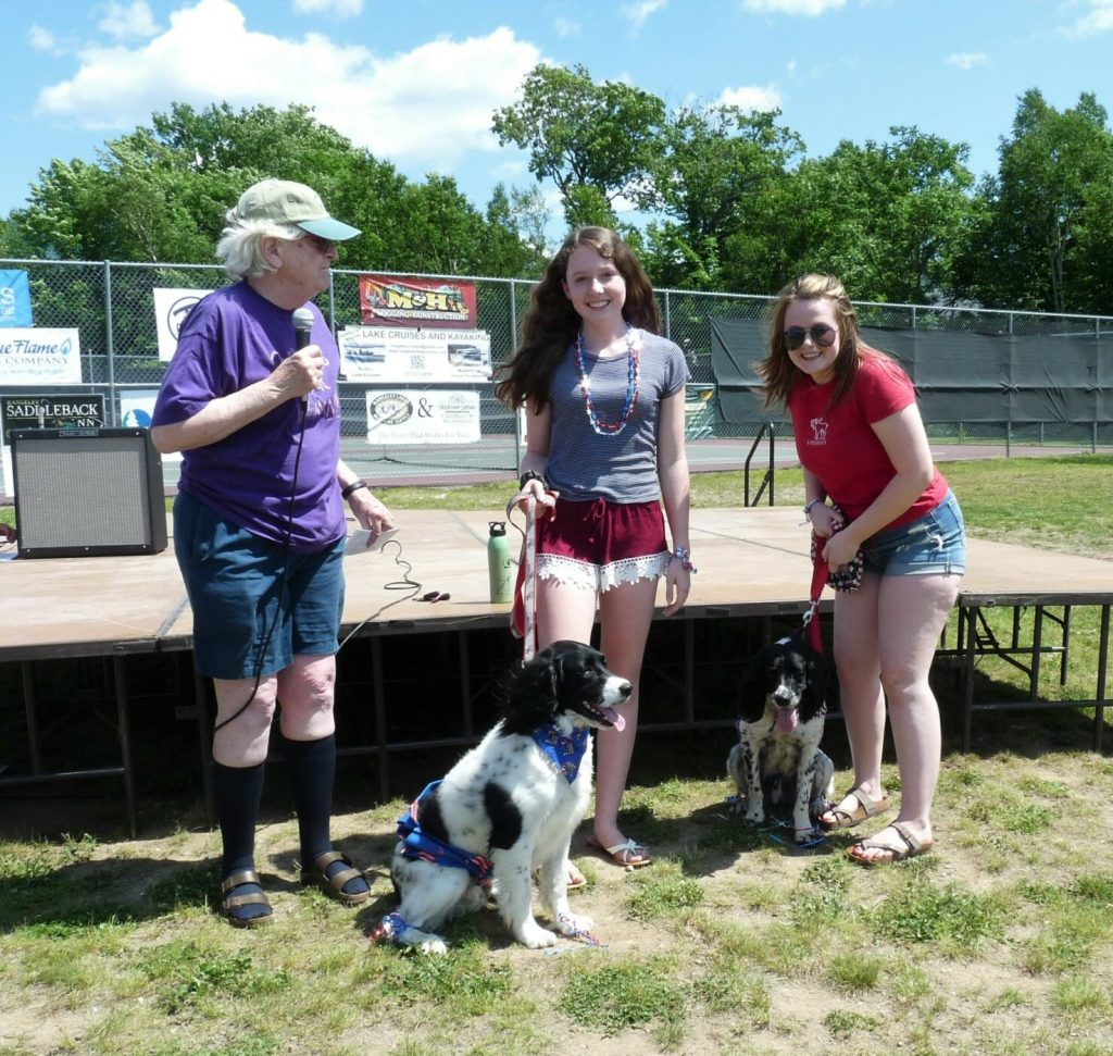 """""""Mozzie"""" and """"Trace"""" with Mirren Hibbert, center, and Lily Grover, with Joanne Dunlap, left, president of the Rangeley Lakes Chamber of Commerce."""