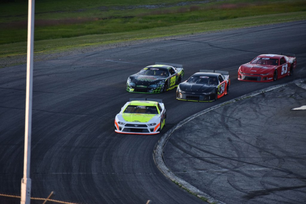 Ben Rowe leads the field during Sunday's PASS 150 at Oxford Plains Speedway in Oxford. Rowe finished second.