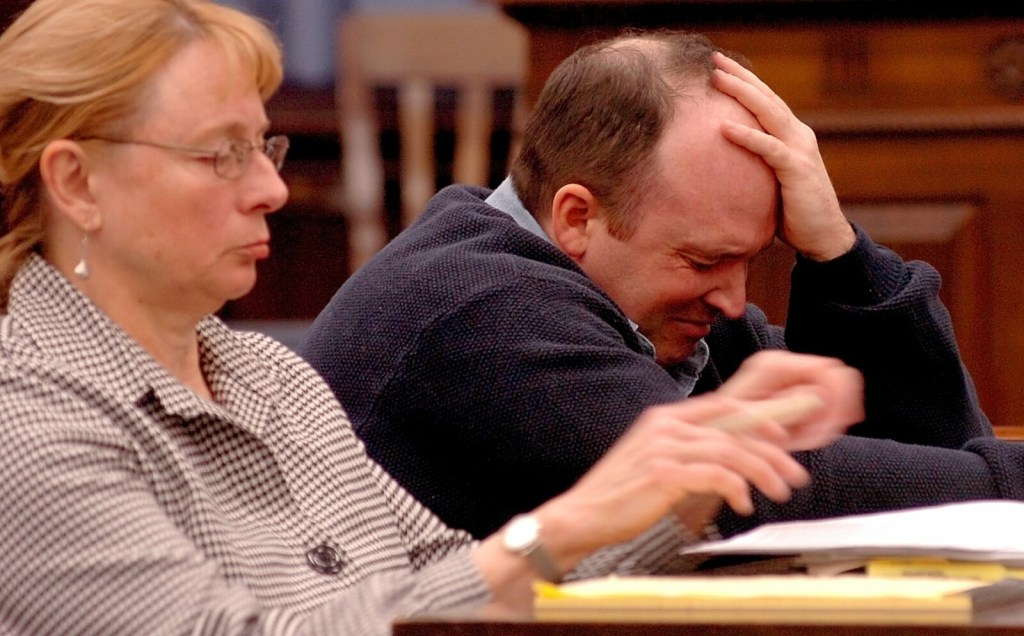 Todd Curry breaks down on Oct. 21, 2015, after brief testimony during a hearing in Somerset County Superior Court in Skowhegan. Curry was found not criminally responsible in the 2006 death of Anthony Tucker. Seated beside Curry is his attorney, Janet Mills, who now is Maine's governor.