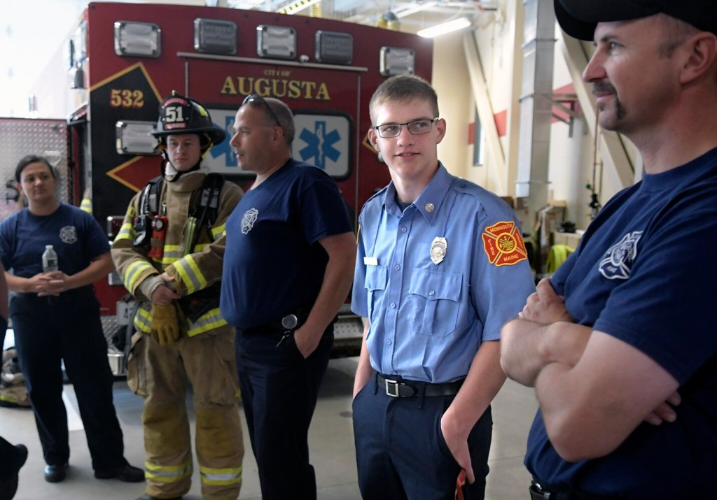 Monmouth Academy senior Logan Farr, second from right, trains Thursday at the Augusta Fire Department. Farr will be enrolling in the Capitol Area Technical Center's firefighting program this school year.