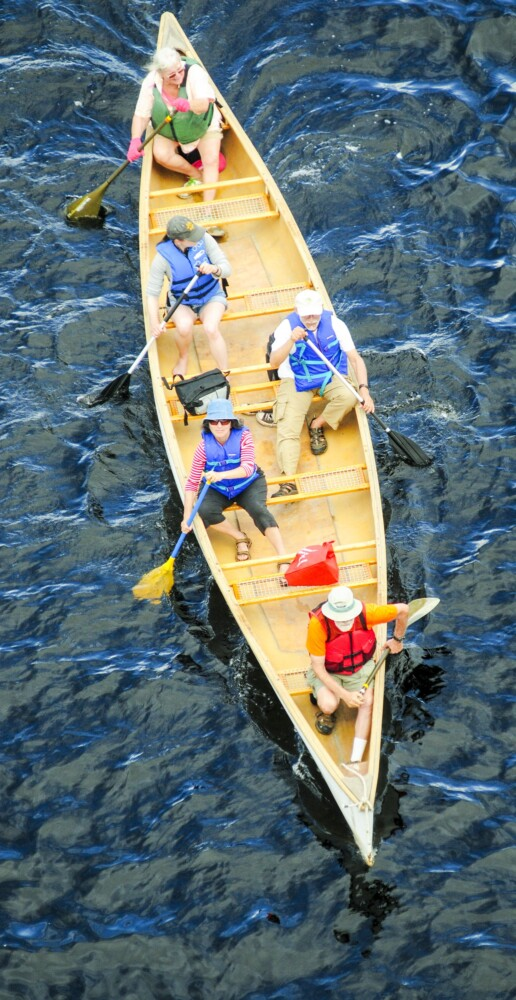 AUGUSTA, ME - AUGUST 10: Paddlers head south near the Cushnoc Crossing bridge during NRCM trip on Saturday August 10, 2019 on the Kennebec River in Augusta. (Staff photo by Joe Phelan/Staff Photographer)