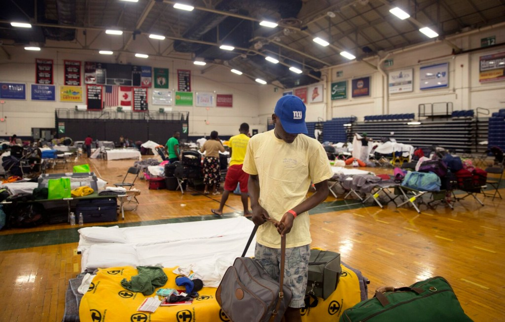 An asylum seeker who asked not to be named packs up this family's belongings on Wednesday. He and his family are being moved to Portland's family shelter.