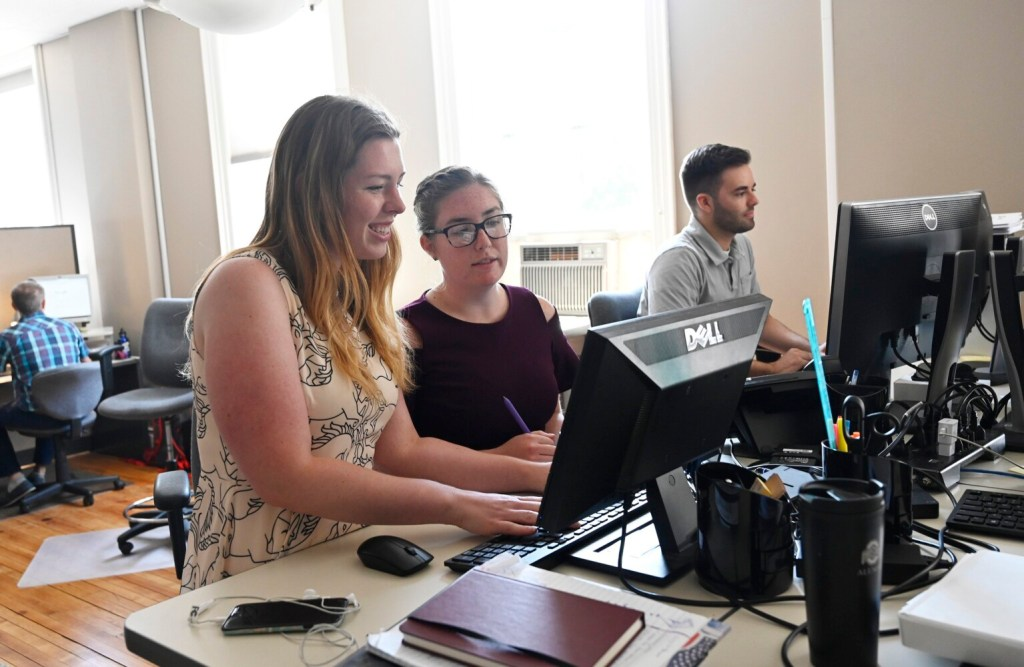 Apprentices Sacha Kiesman, Lauren Whitney and Brian Lee work at WordLab in Portland on Thursday. Almost everyone who completes an apprenticeship goes on to continue working for the sponsoring employer.