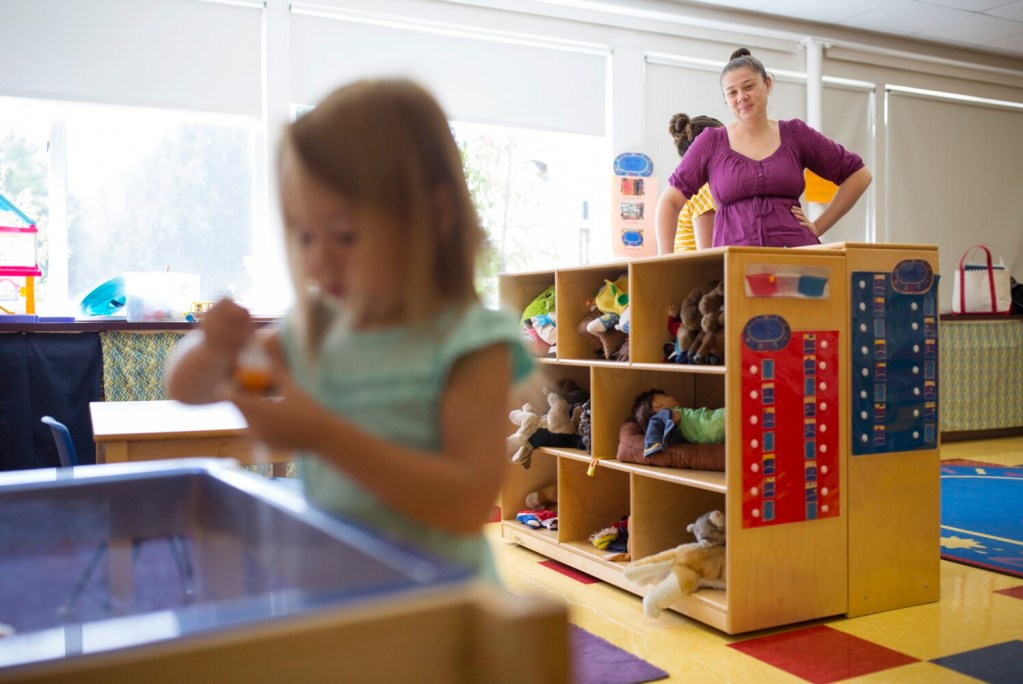 Stacey Menard watches as her new pre-kindergarten student Holly Hibbard, 3, plays in the sandbox during a drop-in day before the start of school this week at Dunn Elementary School in New Gloucester. Gov. Janet Mills has made expansion of pre-kindergarten a priority.
