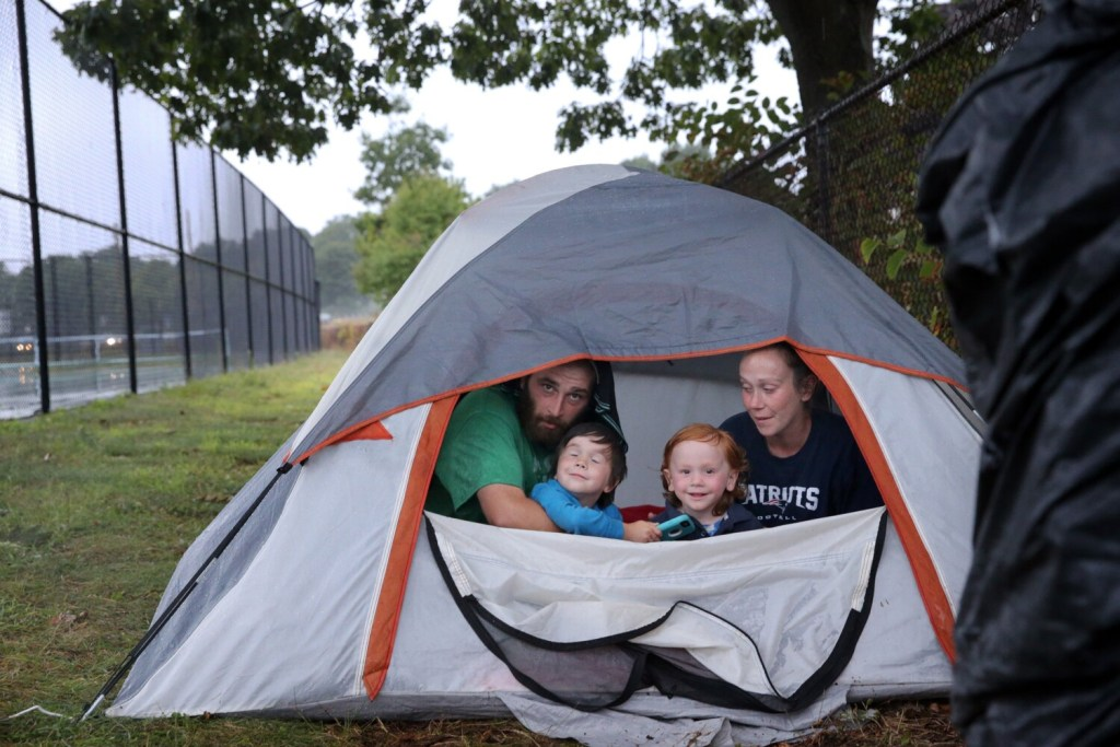 PORTLAND, ME - AUGUST 28: David Pippin, Ashley Livingston and their children David, 5, left, and Harry, 3, are homeless and living in a tent after getting kicked out of a shelter for using their own money to buy school supplies. (Staff photo by Ben McCanna/Staff Photographer)