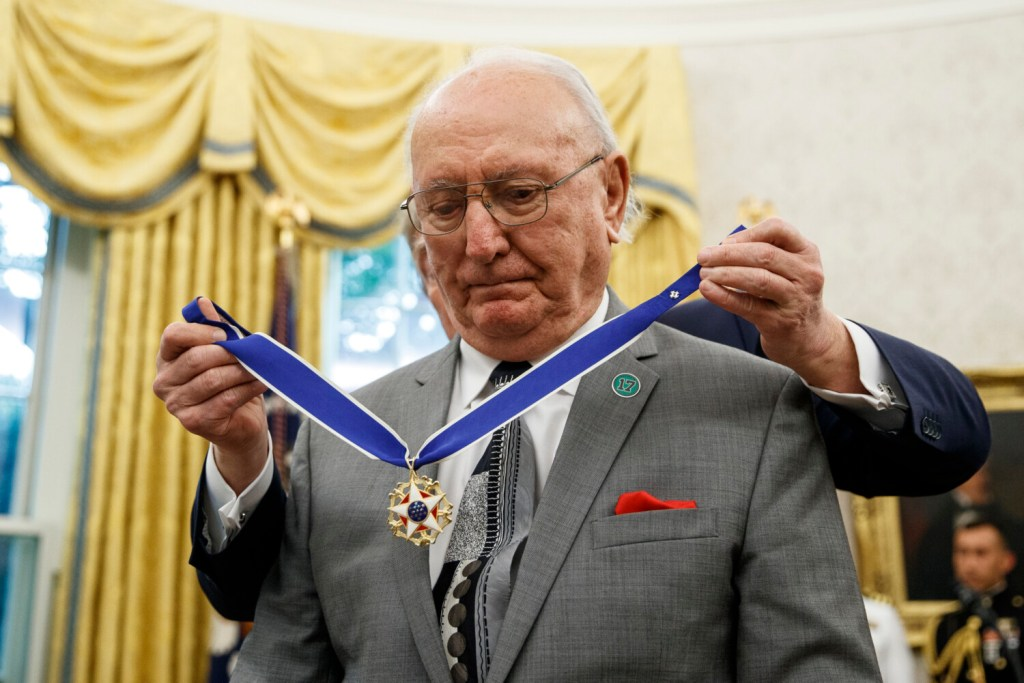 President Trump presents the Presidential Medal of Freedom to former NBA player and coach Bob Cousy of the Boston Celtics during a ceremony at the White House on Thursday.