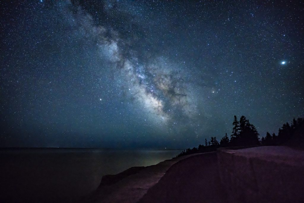 The Milky Way shines above the ocean off the coast of Acadia National Park in the early-morning hours of April 23, 2018.
