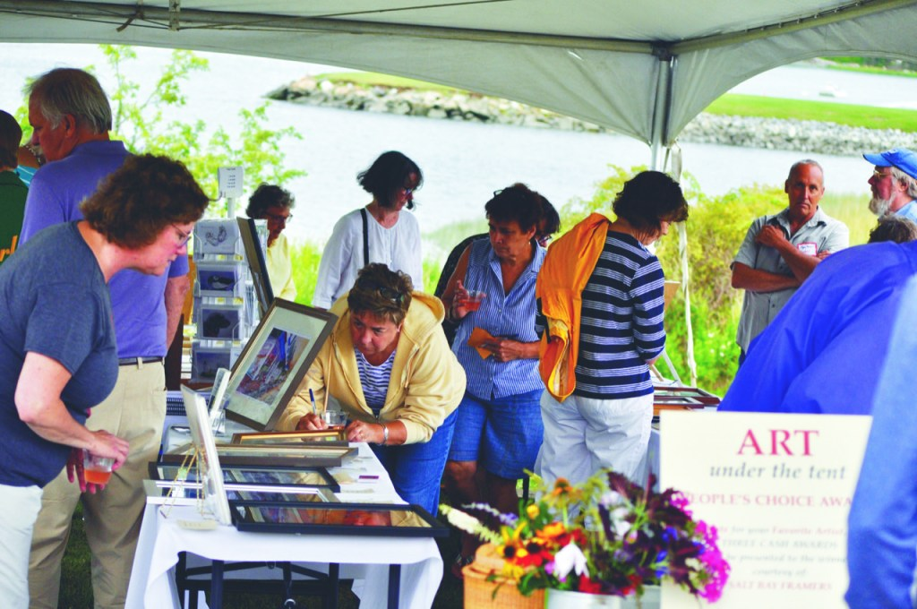 "Community members peruse art on display and fill out ballots for the People's Choice Award during a previous Lobster and More event, with the ""Art Under the Tent,"" held at the Lincoln Home in Newcastle."