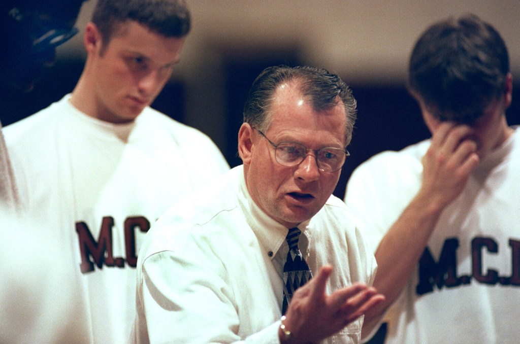 Maine Central Institute prep coach Max Good talks to his team during a timeout of a Jan. 14, 1999 game against Milton Academy.