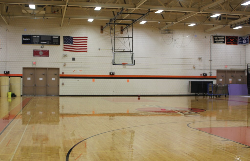The gymnasium of Skowhegan Area High School, where a mural depicting the school's former Native American sports nickname and mascot has been painted over.