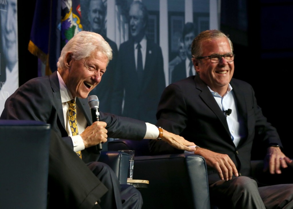 Former President Bill Clinton and former Florida Gov. Jeb Bush laugh during the George and Barbara Bush Distinguished Lecture Series at University of New England in Biddeford on Friday night.