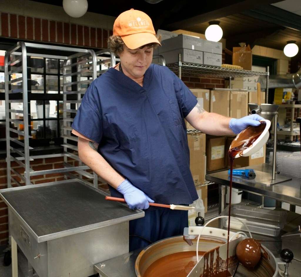 Craig Letowski, kitchen operations manager at Wellness Connection of Maine in Gardiner, adds THC extract to chocolate. Wellness filed a lawsuit Wednesday claiming a contractor it hired to provide extraction equipment and training was in breach of contract.
