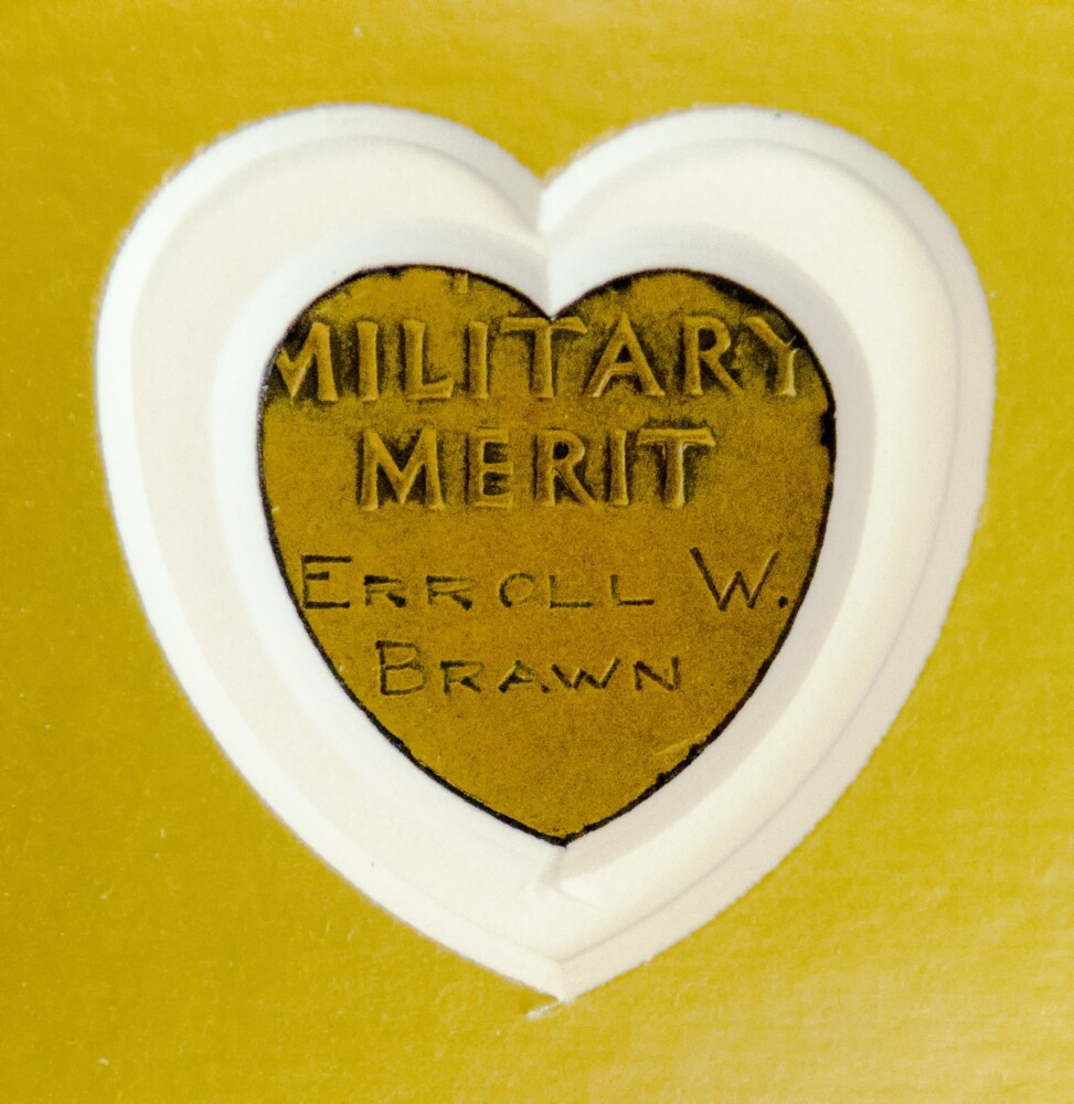 The medal of Sgt. Erroll Wilbert Brawn has a frame with a cutout on the back so the inscription is visible.
