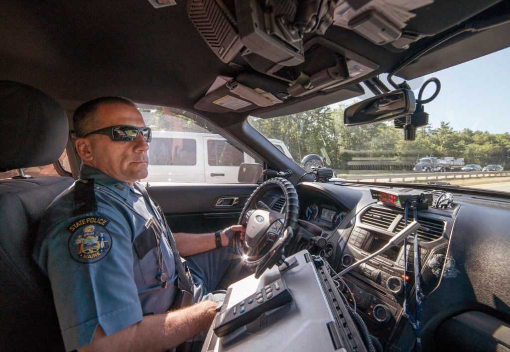 Maine State Police Trooper Anthony Keim patrolled the Maine Turnpike in Scarborough on the first day of Maine's hands-free driving law looking for drivers holding cellphones.