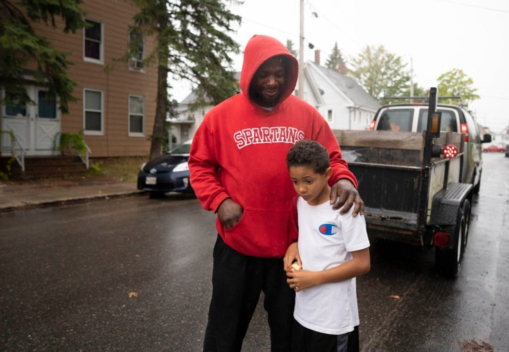 Javon Jarrett stands with his father, Neil, in Sanford on Monday. Neil Jarrett and Javon's mother, Jessica Gouin, say they are disappointed and upset that an assistant principal used a racial slur to make a point about hurtful language while taking with Javon, a fourth-grader at Williard School in Sanford.