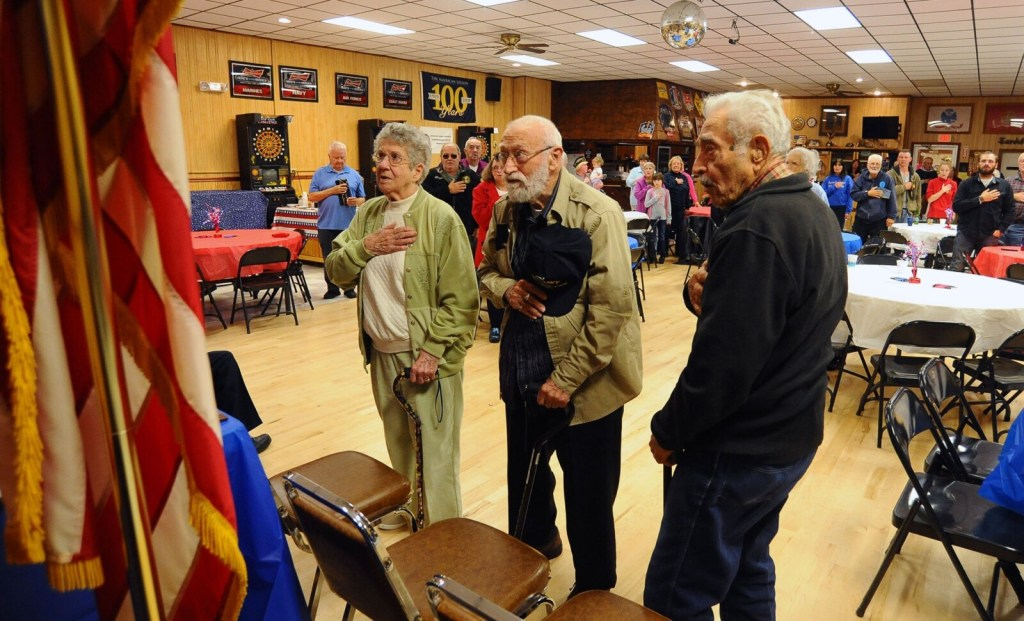 From left, WWII veterans Clara Gilbert, 96; Nunzio Biondello, 95, and Nicholas Ambulos, 91, join in reciting the Pledge of Allegiance at Tardiff Belanger American Legion Post 39 in Madison on Saturday.