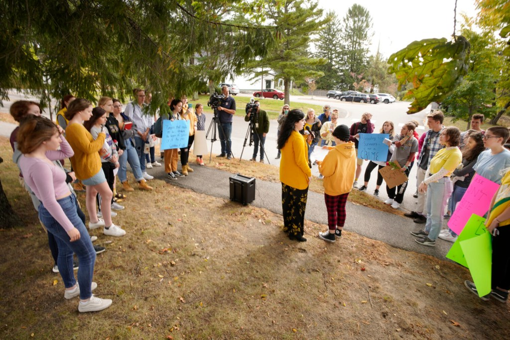 Cape Elizabeth High School senior Christena Gikas, center at left, speaks to students who walked out of school on Monday to protest the suspension of students following complaints of how the school handled recent sexual assault allegations.