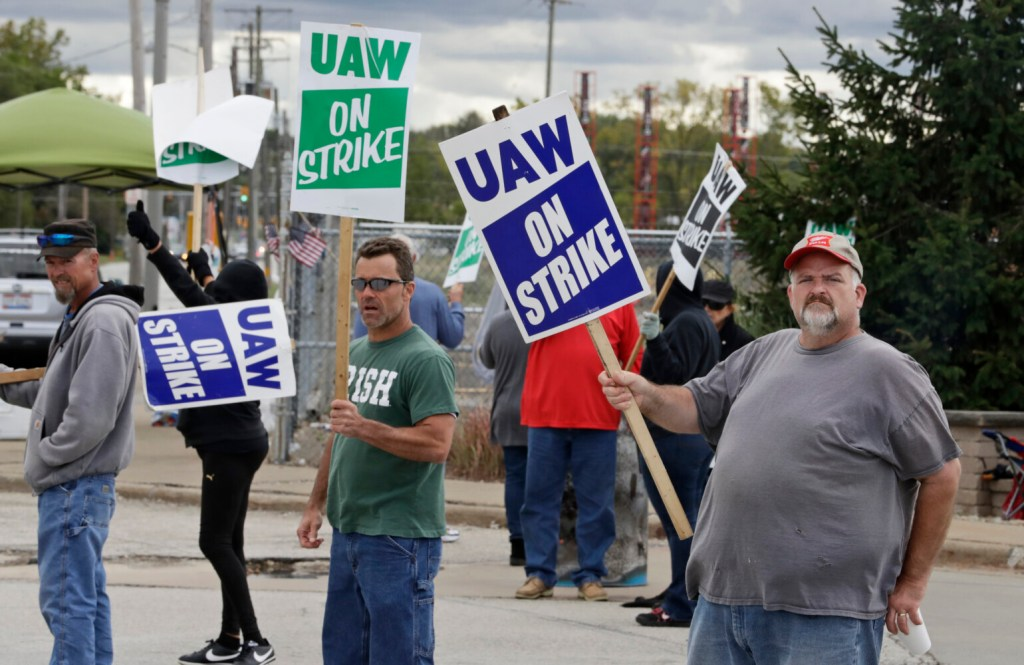 John Kirk, right, a 20-year-employee, pickets with co-workers outside the General Motors Fabrication Division, on Friday in Parma, Ohio.