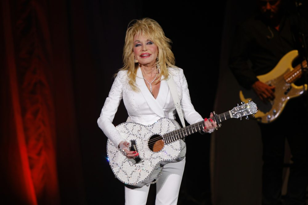 "In this July 31, 2015 file photo, Dolly Parton performs in concert at the Ryman Auditorium in Nashville, Tenn. Parton will perform a new song ""Faith"" in a gospel medley at the Country Music Association Awards  on the Nov. 13 awards show in Nashville, Tenn."
