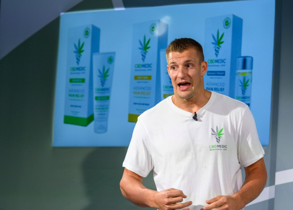 Former New England Patriots tight end Rob Gronkowski holds a news conference announcing his advocacy for CBD and becoming an investor in Abacus Health Products, the maker of CBDMEDIC, Aug. 27, 2019, in New York.