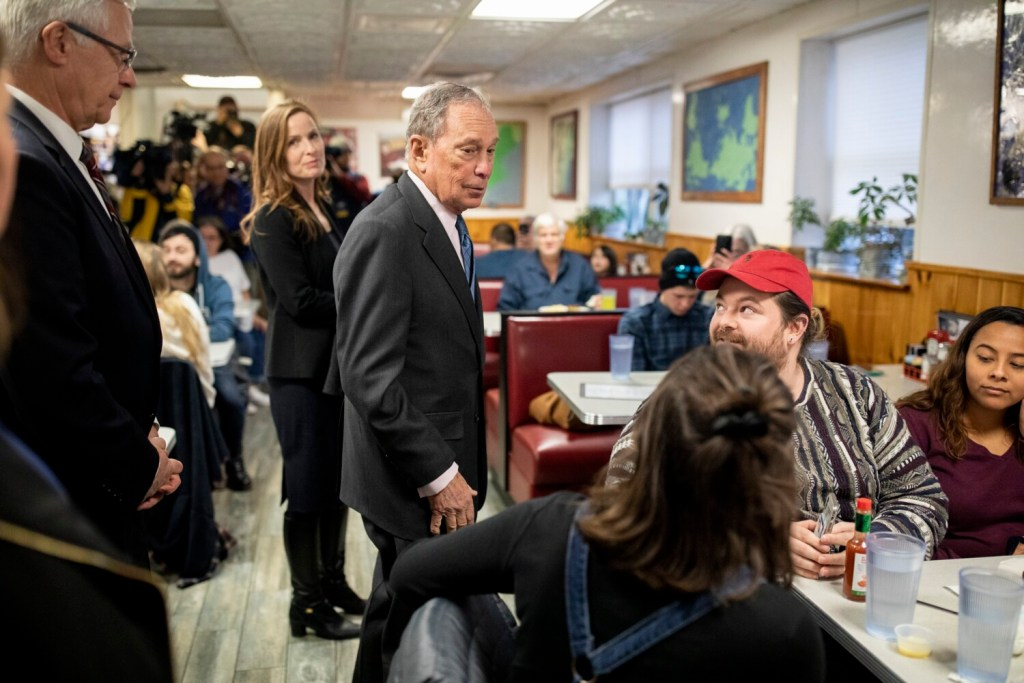 Presidential candidate Mike Bloomberg has a quick chat with patrons at Becky's Diner in Portland during a campaign visit to Maine on Monday.